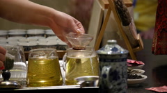 Chinese Ginseng Black Tea Being Poured Stock Footage