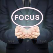 Stock Illustration of businessman holding focus word