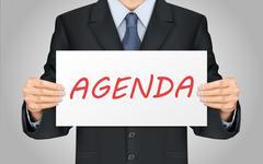 businessman holding agenda poster - stock illustration