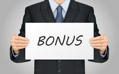 businessman holding bonus poster - stock illustration