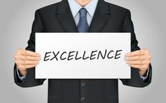 businessman holding excellence poster - stock illustration