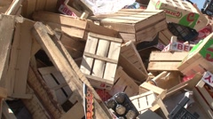 Warehouse for processing waste.Wooden boxes. Mountains of garbage. Stock Footage