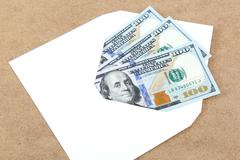 Money in envelope on wooden background. Stock Photos
