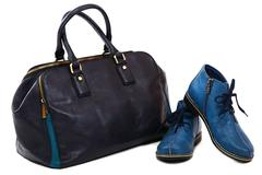 Modern women's fashion footwear and bag against white background. - stock photo
