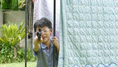 Boy playing with gun. Stock Footage
