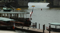 Pedaling yellow pedal boats on Vltava River, Prague Stock Footage