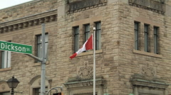 Flag, zoom-out,Canada Post old historical building street view. Stock Footage