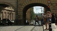 Tourists crossing the Krizovnicka street, near Charles Bridge, Prague Stock Footage