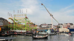 Boats and fairground in Leiden, Holland Stock Footage