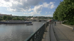 Boats floating on Vltava River and tourists taking pictures, Prague Stock Footage