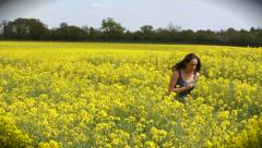 Woman in flower field (wideshot and part of a sequence) Stock Footage