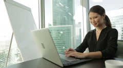 Young Asian Business woman at office with laptop, typing, Dolly shot Stock Footage
