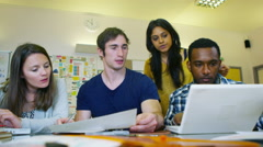 4K Mixed ethnicity student group working together in college Stock Footage