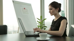 Young Caucasian Business woman at office with laptop, typing, Dolly shot Stock Footage