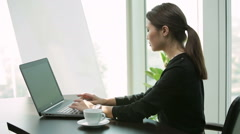 young Asian Business woman at office with laptop, typing - stock footage