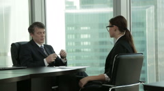 The job of a recruiter conducts an interview with a young Caucasian applicant, a Stock Footage