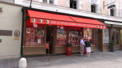 4k Famous Mozart praline shop Salzburg city Austria Stock Footage
