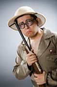 Stock Photo of Funny hunter in hunting concept