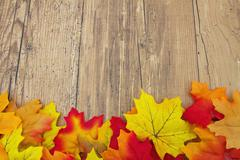 Autumn Leaves and Weather Wood Background - stock photo