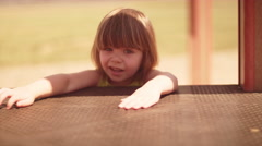 A little girl standing by a play structure Stock Footage