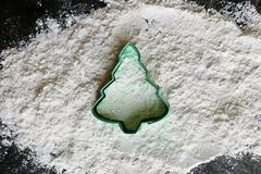 Christmas Tree Cookie Cutter in Baking Flour - stock photo