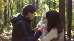 Asian Family with child go in autumn park Stock Footage