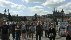 Many tourists walking on Charles Bridge (Karlův most) in Prague Stock Footage