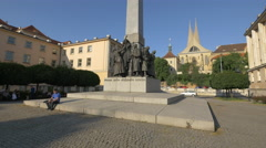 Man relaxing near the Czechoslovak Legion monument in Prague Stock Footage