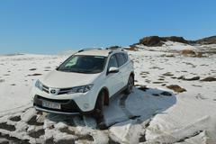 Toyota RAV4 on snowy terrain Stock Photos