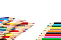 Sharpened colored pencils on a white background. - stock photo