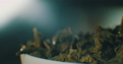 The leaves green tea and tea particles. Stock Footage