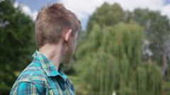 4K Portrait of smiling young boy outdoors in natural environment Stock Footage