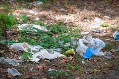 Pile of domestic garbage in park Kuvituskuvat