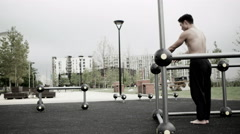 4K Very fit Asian man working out in outdoor urban environment - stock footage