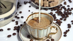 Coffee with milk. Adding milk to coffee.  Slow motion 240 fps. Stock Footage