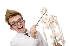 Funny doctor with skeleton isolated on white Kuvituskuvat