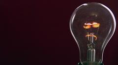 Light bulb lights up. Full HD 1080 video footage. - stock footage
