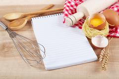 Stock Photo of Baking ingredients for cooking and notebook for recipes.