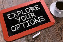 Handwritten Explore Your Options on a Chalkboard - stock illustration