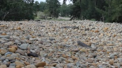 Texture footage of Rounded Rocks and Pebbles - stock footage