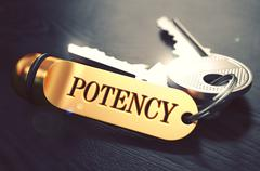 Stock Illustration of Potency - Bunch of Keys with Text on Golden Keychain