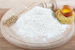 Baking ingredients for cooking on a wooden board. - stock photo