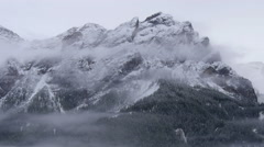 Clouds along dolomite smowy summit 4k 11705 Stock Footage