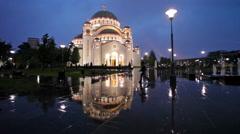 Saint Sava temple on the rainy night Stock Footage