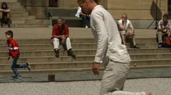 Men performing for tourists in Jan Palach Square, Prague Stock Footage