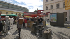 Souvenirs and flowers stalls in the Republic Square of Prague Stock Footage