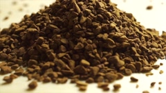 Rotating pile of instant coffee, macro video Stock Footage