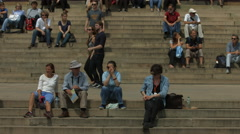 Tourists sitting on stairs in Jan Palach Square, Prague Stock Footage