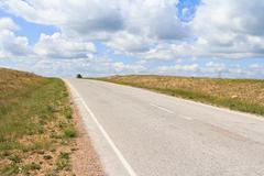 The asphalt  road running diagonally over the horizon Stock Photos