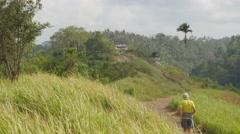 Jogger on the ridge,Ubud,Bali,Indonesia Stock Footage